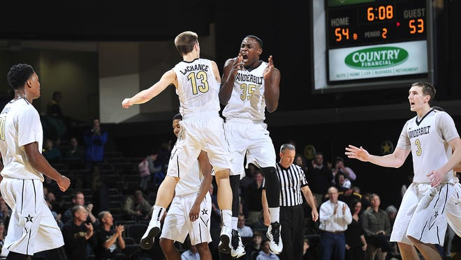 Vanderbilt's Riley LaChance (13), James Siakam (35) and the Commodores will play in the NIT.