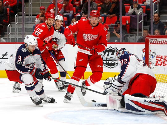 Blue Jackets goalie Sergei Bobrovsky (72) stops a Red Wings right wing Anthony Mantha (39) shot as Blue Jackets left wing Artemi Panarin (9) defends in the second period on Saturday, Nov. 11, 2017, at Little Caesars Arena.