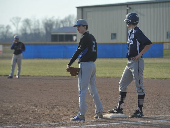 Noah Smith looks to his catcher with a runner on first.