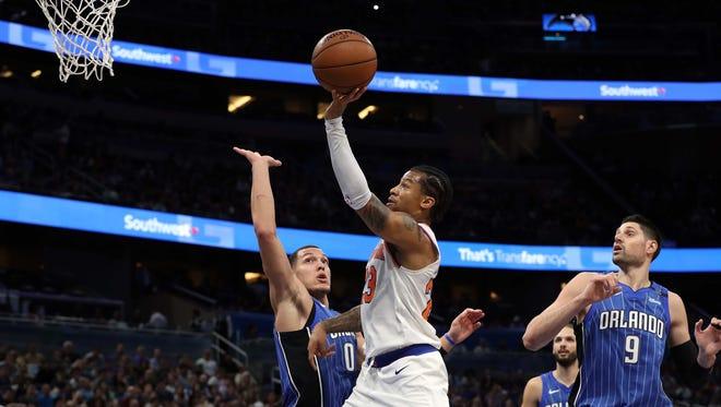New York Knicks guard Trey Burke (23) shoots over Orlando Magic forward Aaron Gordon (00) during the second quarter at Amway Center.