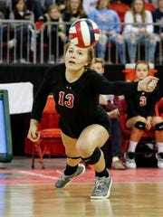 Lourdes' Claire Chier (13) gets a dig against Clayton during Saturday's match at the Resch Center.