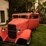 A classic 1932 Ford Deuce Coupe hot rod stands in striking contrast to the rural English scenery on Jeff Beck's property. The guitarist keeps a dozen hot rods in his garages, and works on them himself.