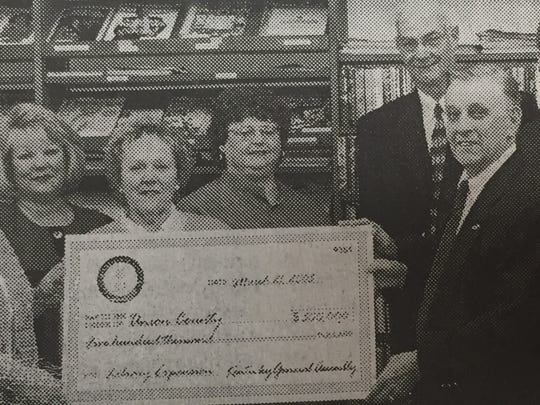 The Union County Library received $500,000 in April 2005 for expansion plans. Pictured from left Bonnie Edmondson, Gwen Royster, Cathy Greenwell, Cheryl Berry, Vicki French, District Librarian Laura Wildey, Union County Judge Executive Larry Joe Jenkins, State Rep. John Arnold, Senator Dorsey Ridley and Magistrate Bobby Veatch.