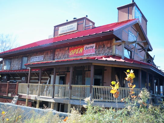 Black Mountain Stove & Chimney, at 201 Black Mountain Ave., is open despite the Oct. 25 fire.
