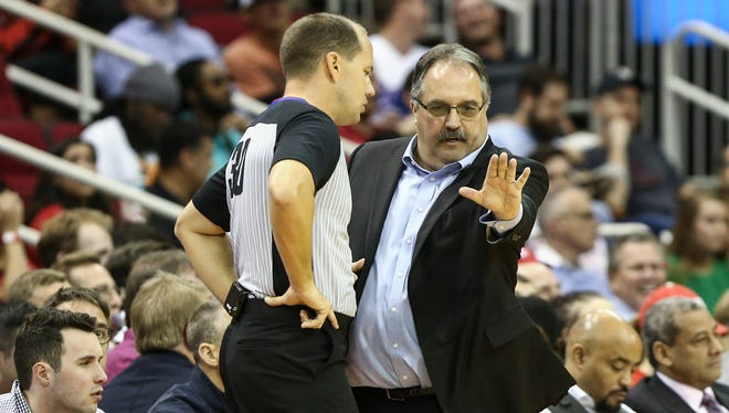 Pistons coach Stan Van Gundy talks with an official during the third quarter of the Pistons' 100-96 overtime loss on Thursday, March 22, 2018, in Houston.