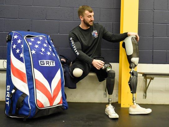 Marine veteran Joey Woodke puts his prosthetics back