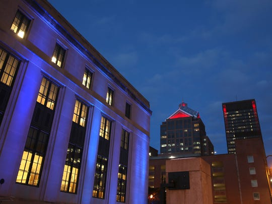 Colored lights highlight some of the architectural treasures in downtown Rochester, including the Rundel Library, left, the Legacy Tower, center, and the Xerox tower, right.
