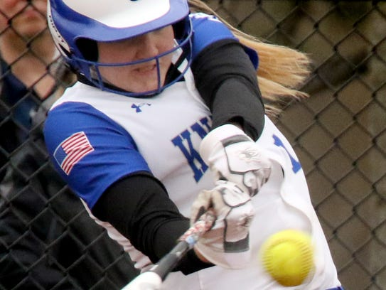 Oak Creek's Jenna Trewyn digs into a two RBI, double