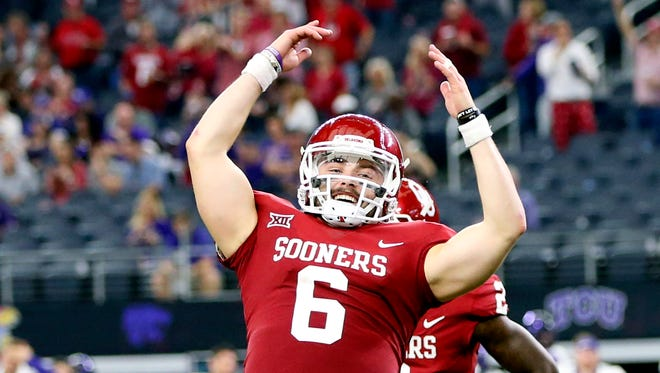 Oklahoma Sooners quarterback Baker Mayfield (6) celebrates after the victory against the TCU Horned Frogs in the Big 12 Championship game at AT&T Stadium.