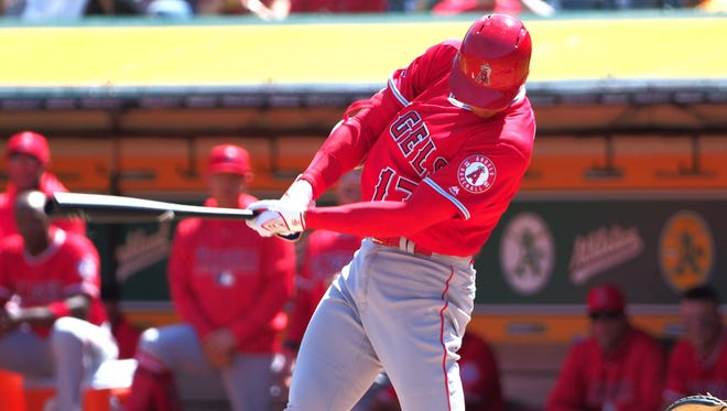 Angels designated hitter Shohei Ohtani rips a single in his first major-league at-bat against the Athletics during the second inning at Oakland Coliseum in Oakland.