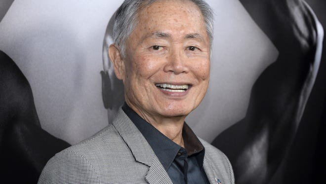 """George Takei FILE - In this March 15, 2016 file photo, actor George Takei attends the premiere of """"Mapplethorpe: Look at the Pictures"""" in Los Angeles, Calif.(Photo by Phil McCarten/Invision/AP, File)"""