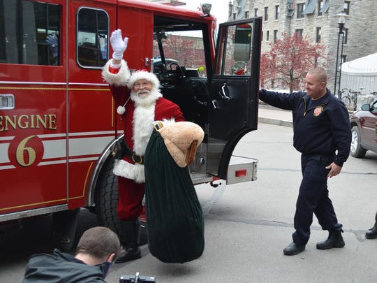 Santa Claus arrives by fire truck Wednesday at the Vermont Children's Hospital.