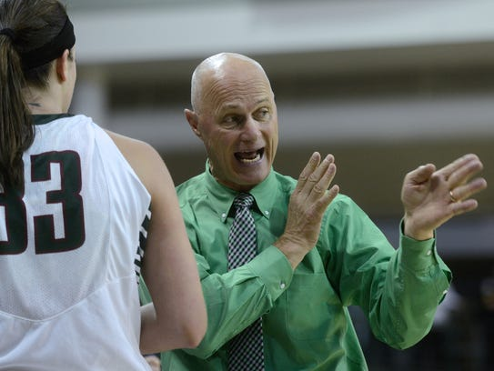 Green Bay Phoenix coach Kevin Borseth advises center