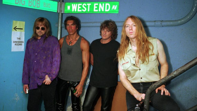 Members of the band Dokken, from left; Don Dokken, George Lynch, Jeff Pilson, and Mick Brown, pose backstage before a concert in Chicago on July 27, 1995.