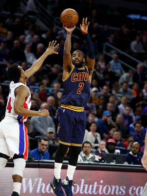 Kyrie Irving of the Cavaliers shoots over Ish Smith of the Pistons during the Pistons' 106-101 win at the Palace on Thursday, March 9, 2017.