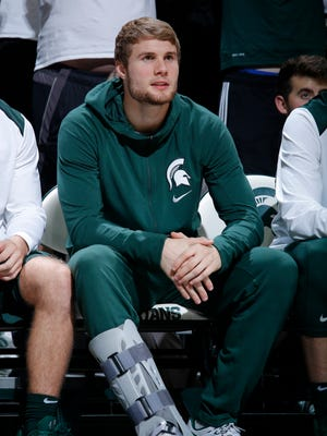 Michigan State junior Kyle Ahrens, shown here watching the Spartans play Hillsdale last season, made his first appearance at the Moneyball Pro-Am on Thursday night after missing all of last year with a foot injury.