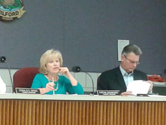 Cynthia Dagenhardt, Milford Township treasurer, makes a point during a discussion about tax abatement for Battery Solutions.