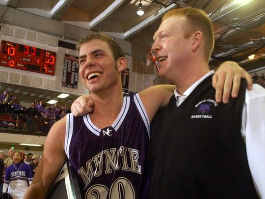 Central's Alex Daniel, left, and coach Matt Fine share