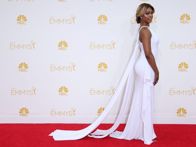For the stars, a night made of cherry and cream | Orange may be the new black, but when it came to Emmys fashion Monday night, red and white ruled the roost. Whether fiery in red or cool in white, these stars showed their style savvy on TV's big night. Reporting by:  Bryan Alexander, Cindy Clark, Donna Freydkin, Bill Keveney, Andrea Mandell, USA TODAY <br /> Laverne Cox arrives in blazing white at the 66th annual Emmy Awards at the Nokia Theater Aug. 25, 2014.<p></p>