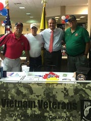 Representatives from Vietnam Veterans of  Vero Beach with Wayne Zwick, manager of Velde Ford.
