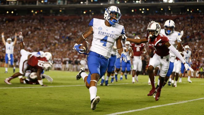 Kentucky running back Mikel Horton (4) runs into the end zone for a touchdown in the first half of an NCAA college football game against South Carolina Saturday, Sept. 12, 2015, in Columbia, S.C. (AP Photo/John Bazemore)