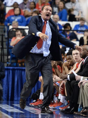 Scott County head coach Billy Hicks reacts to a call on the floor during the second half of the KHSAA Boys Sweet Sixteen Basketball Tournament game between Trinity and Scott County at Rupp Arena in Lexington, KY. Saturday, March 22, 2014. Scott County won the game 62-56. Photo by Mike Weaver, Special to the C-J.