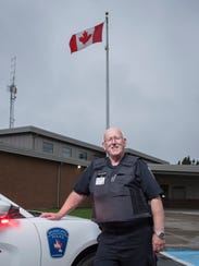 Gander Municipal Police Constable Oswald Fudge outside