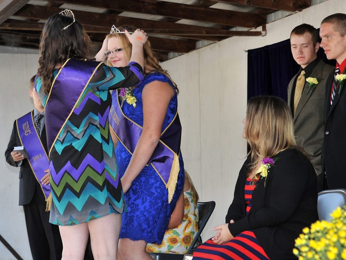 Katricia Phillips was crowned the 2014 Coshocton County Fair Queen by 2013 Queen Emily Hardesty Saturday morning during the opening ceremony of 163rd Coshocton County Fair.