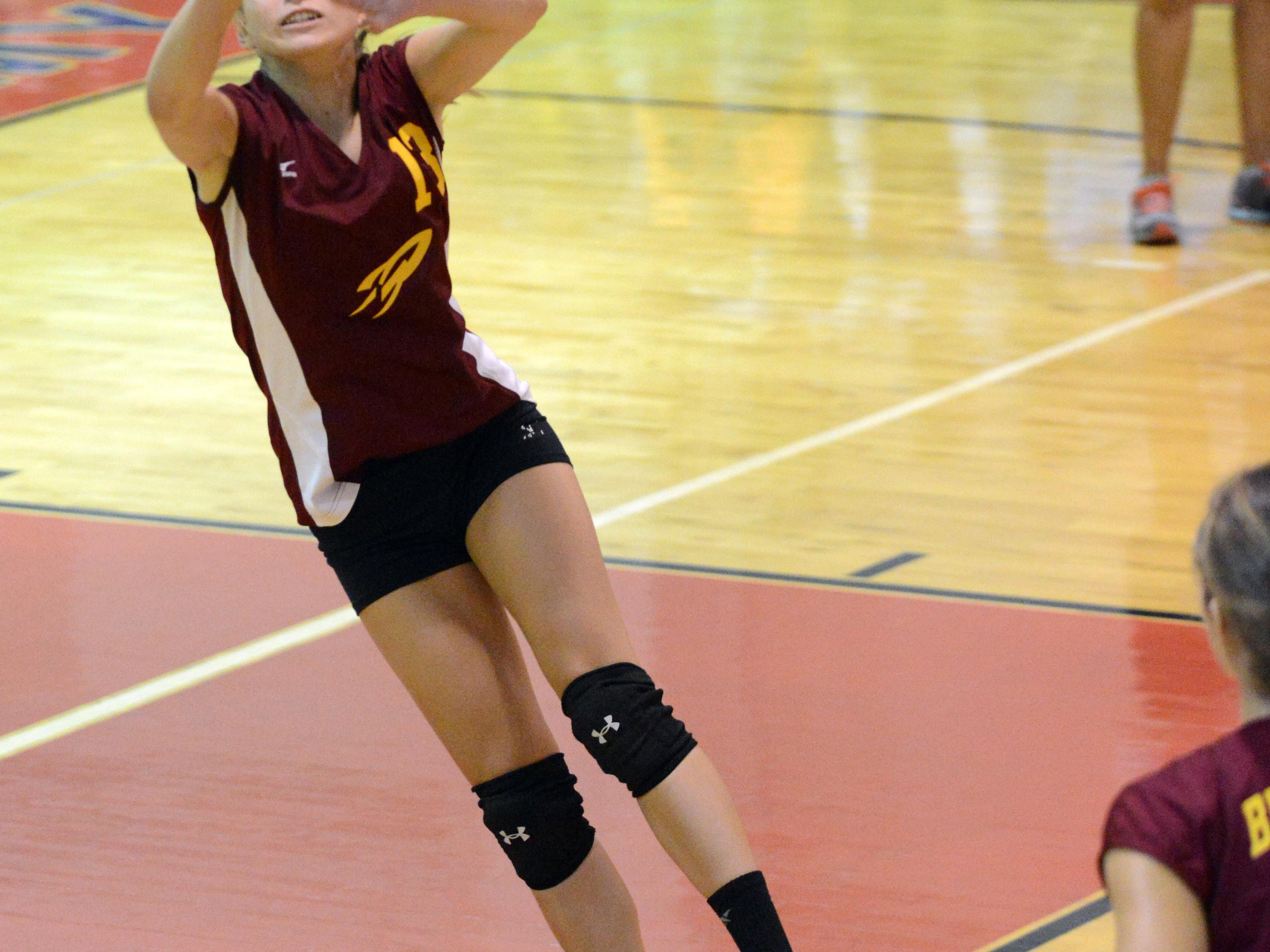 Berne Union's Alexis Lanier sets the ball during Thursday's game against Fairfield Christian in Lancaster. The Rockets won the match three games to two.