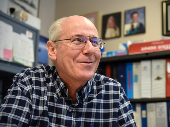 Boys & Girls Clubs Director Mark Sakry smiles while talking about his work during an interview in his office Tuesday, Jan. 16, in St. Cloud.