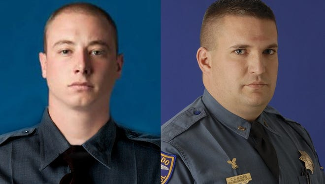 Colorado State Patrol cadet Taylor Thyfault, left, and Trooper Clinton Rushing.