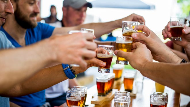 Guests drink samples from a flight of beers during a tour of Bayou Teche Brewing in Lafayette, La., Saturday, May 9, 2015.