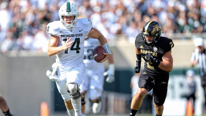 Western Michigan redshirt sophomore safety Justin Tranquill chases Michigan State quarterback Brian Lewerke on Saturday, Sept. 9, 2017 in East Lansing, Mich.