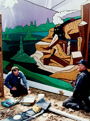 1994: Peter Krai (left) of Forked River and Tim Healy (right) of Edison work on  a display at Bugs Bunny Land.