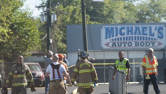 Police and firefighters investigate a fire at Michael's Auto Body in Cinnaminson.