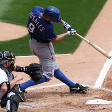 CHICAGO, IL - AUGUST 06: Adam Rosales #9 of the Texas Rangers hits a two-run home run in the 2nd inning in front of Tyler Flowers #21 of the Chicago White Sox at U.S. Cellular Field on August 6, 2014 in Chicago, Illinois. (Photo by Jonathan Daniel/Getty Images)