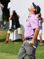 Michael Arnaud reacts on the 18th green after winning