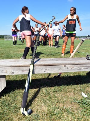 Cumberland Regional High School players hand off sticks during a practice drill on Wednesday, August 31, 2016. Photo/Charles J. Olson