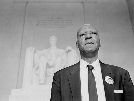 A. Philip Randolph, one of the chairmen for the March On Washington demonstration in Washington D.C., stands in front of the statue of Lincoln at the Lincoln Memorial following the two-pronged parade through the streets of the capital, Aug. 28, 1963.