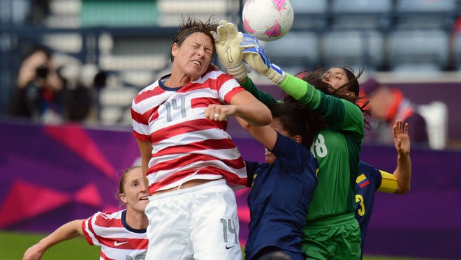 Pittsford native Abby Wambach (14), shown here competing in 2012 London Olympics, scored 77 of her record 184 goals with her head.