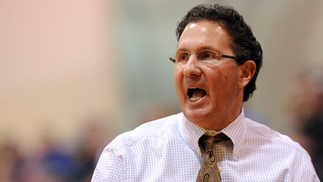 Marian University head basketball coach Todd Lickliter yells to his players on the floor against Bethel College inside the Physical Education Center, Saturday, January 11, 2014, in Indianapolis. Twenty-fourth ranked Marian University defeated fourth ranked Bethel College 77-70.