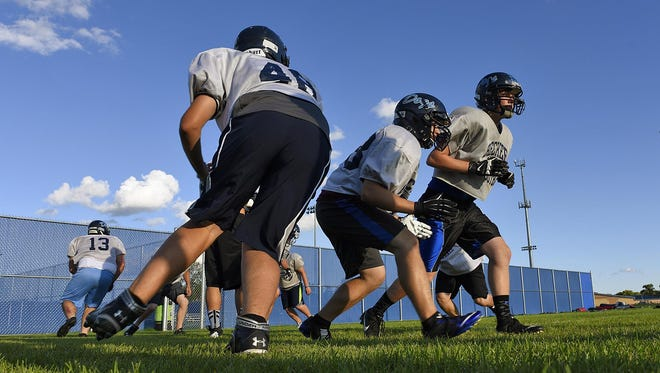 Becker linemen work on blocking assignments Thursday during practice.
