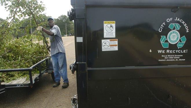 Robert Johnson of Jackson unloads debris during the City of Jackson's Roll off Dumpster Day.