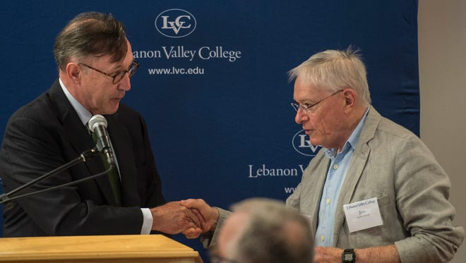 Lewis Thayne,left, president of Lebanon Valley College, presents a check for $13,000 to Jim Scott, Annville Township commissioner, as Lebanon Valley College kicks off its academic year with an opening breakfast on Wednesday, Aug. 24, 2016. Thayne also announced that the college would donate an additional $13,000 to the township in the spring.