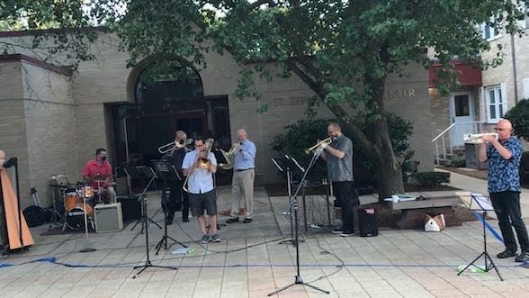 Musicians gathered on the St. Zepherin Church plaza, while listeners gathered in a socially distant manner or listened from their cars as the concert was streamed on FM radio.