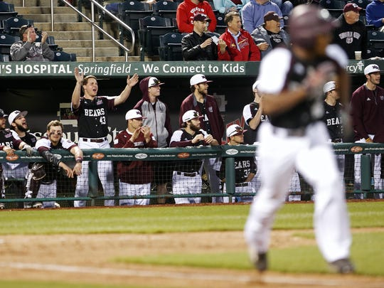 The Missouri State Bears bench cheers after outfielder