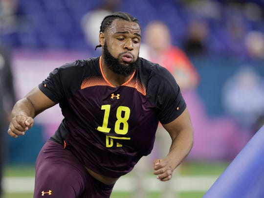 Clemson defensive lineman Christian Wilkins runs a drill during the NFL football scouting combine Sunday in Indianapolis.