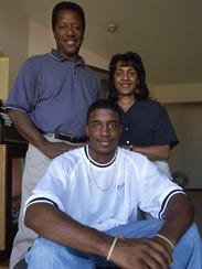 Marcus Taylor poses with his parents, James and Kay,
