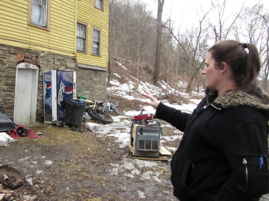 Jennifer Chilson describes how flood waters from the Chemung River came right up to her back door last month.