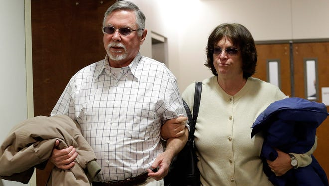 Robert and Arlene Holmes, parents of Aurora theater shooting suspect James Holmes, arrive at district court in March 2013 for an arraignment of their son.